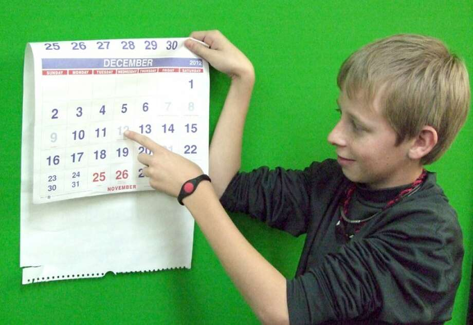 Skyler Steen points to the calendar on this date, as he turns 12 on 12-12-12. Steen was born at Covenant Hospital Plainview and has been looking forward to today since he realized the anomaly of this birthday back in September. His classmates at Ash Elementary think he's lucky to have an all-12 birthday. Photo: Shanna Sissom/Plainview Herald