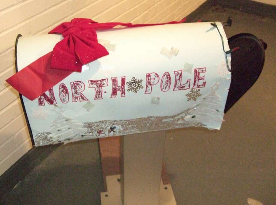A mailbox once used for Santa letters sits in the basement at the U.S. Post Office in Plainview. The new postmaster, Matthew Dolle, will look into implementing a USPS-approved Santa letter program by next Christmas. Photo: Shanna Sissom/Plainview Herald