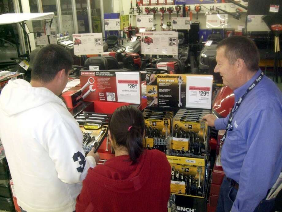 "Sears manager Jim Wright (right) shows Lorenzo and Susan Hinojos of Kress a wrench set around 6 a.m. on Nov. 27, 2010. Sears opened its doors at 4 a.m. for ""Black Friday"" last year, and Wright said the store was very busy. ""It's been crazy,"" he said. Photo: Kevin Lewis/Plainview Daily Herald"