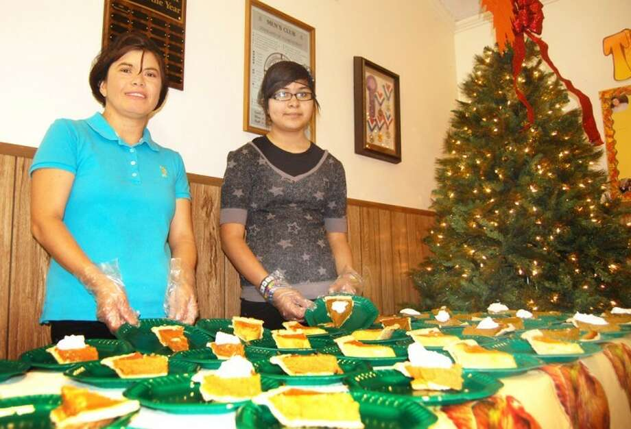 Doug McDonough/Plainview HeraldAngie (above, left) and Mirabel Magallanes manned the dessert table Thursday at The Salvation Army in Plainview. This year was the first time the Army offered a Thanksgiving meal locally, with volunteers from the community as well as from Wayland and other schools helping prepare and serve the meal. In the past many of those same volunteers traveled to Lubbock to help serve The Salvation Army holiday meals there.