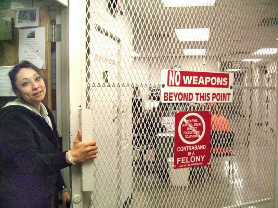 Shanna Sissom/Plainview HeraldCorrections Officer Debby Alaniz opens the security door which leads away from freedom and to the book-in area of the Hale County jail.