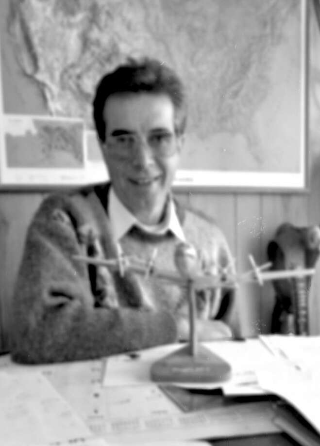 Herald File FolderLonghorn Aviation operator Albert Eisenhuth sits at his desk for an interview in 1992. While operating his flight school in Plainview in the early 1990s, he helped hundreds of Europeans receive pilot certification.