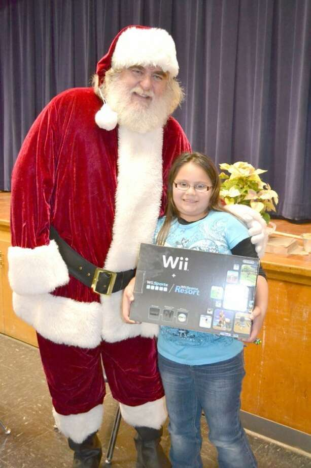 Plainview ISD PhotoThird-grade student Chloe DeLeon was the winner of the Wii for the third six-weeks at College Hill Elementary. Tickets to enter the drawing are given to students who put their best effort into their work at all times. There is a new winner at the end of each six-weeks grading period. This time Santa Claus drew the winning ticket.
