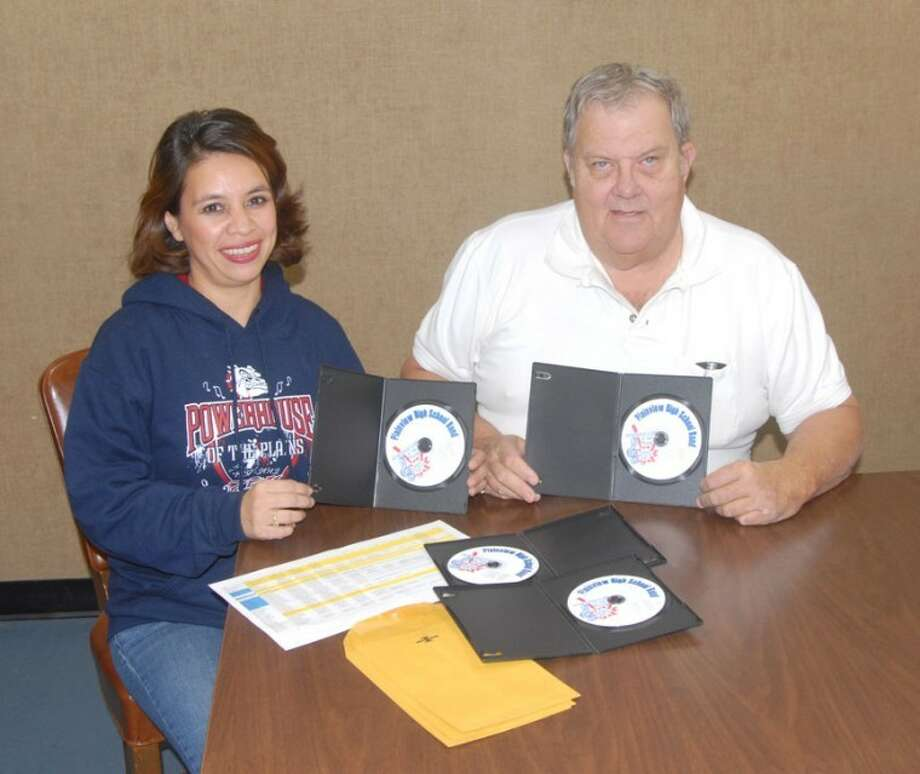 "Plainview Band Boosters President Rose Ann Chavez and video project coordinator Charles Bechtold display some of the Plainview High School ""Powerhouse of the Plains"" Marching Band DVDs that are ready for delivery. As a fundraiser for its scholarship fund, the Band Boosters are distributing video discs of past marching performances of the PHS band, including UIL contests and the 1973 Dallas Cowboys halftime show. Cost for up to 10 performances is $30 plus shipping. Most dates are available from 1959 to 2012. Requests for order forms and other inquiries should be emailed to phsbanddvd@suddenlink.net. Band Boosters also will soon be taking orders for special commemorative T-shirts and hooded sweatshirts marking the band's 75th consecutive First Division rating in UIL marching competition. That sale will be conducted the last two weeks of January. Orders can be placed by calling the PHS band hall at 296-3335."