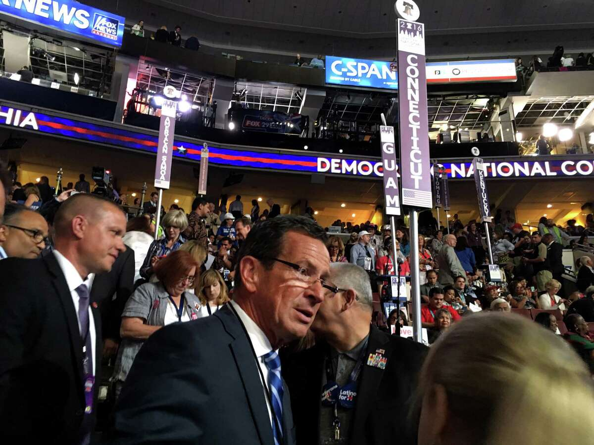 Connecticut Gov. Dannell P. Malloy mingles with the sate's delegates at the Democratic National Convention inside the Wells Fargo Arena in Philadelphia, PA on Monday, July 25, 2016.