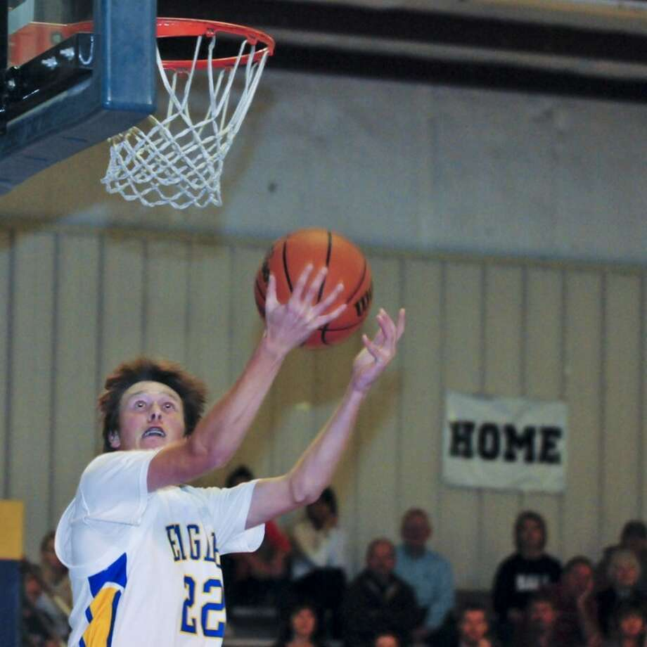 Ryan Thurman/Plainview HeraldThe Plainview Christian Eagles' Braden Landtroop makes a layup during Tuesday's game against Wilson.