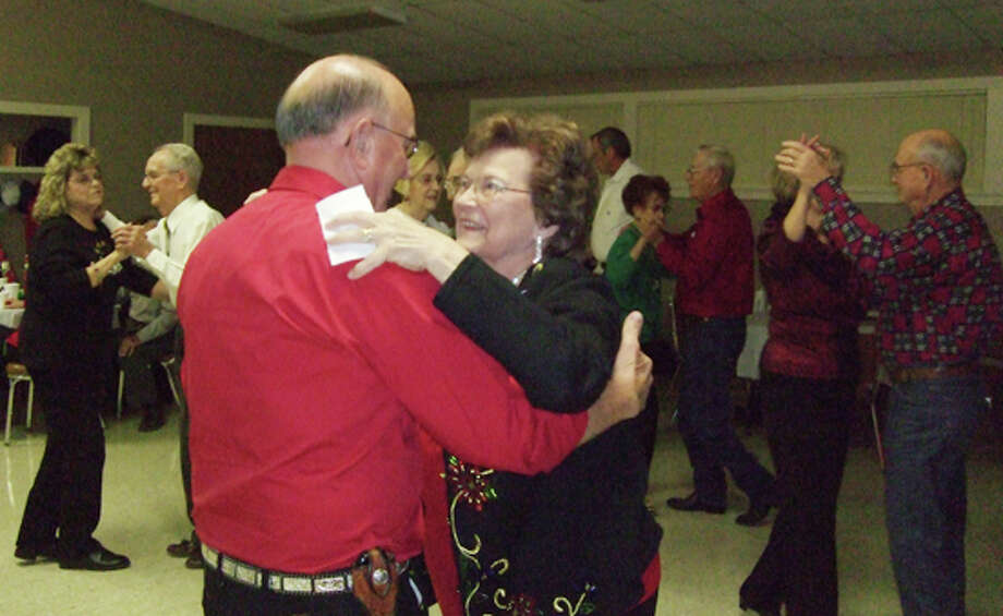 Jimmy and Barbara Jackson, the emcees, show off their waltzing technique. Photo: Gail M. Williams | Plainview Herald