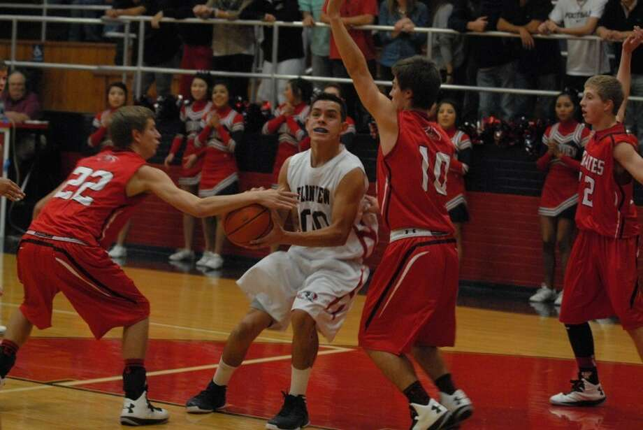 Bulldog Desmond Vera powers his way to the hoop during a recent Plainview game. Against Randall, Vera led the Dogs in scoring with 21 points. Photo: Homer Marquez/Plainview Herald