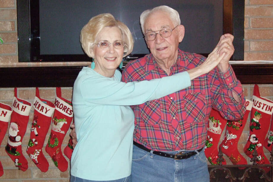 Gail M. Williams/Plainview HeraldDoc and Mary Helen Cross strike a dance pose in front of their fireplace. The Plainview couple have been married 63 years and dancing together 65 years.