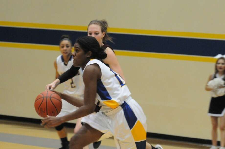 Wayland Baptist's Christie Mooney had four points and two steals in the Flying Queens' 64-50 victory Monday night over McMurry University. Photo: Wayland Baptist University Photo