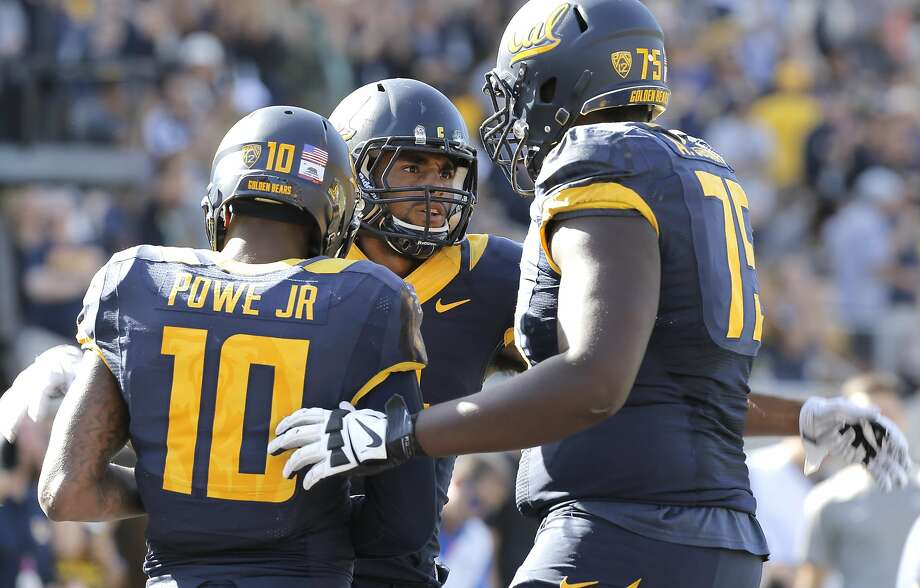 Cal's Kenny Lawler, 4 celebrates his 3rd quarter touchdown pass with teammates Darius Powe Jr, 10 and Aaron Cochran, 75 as the California Bears went on to beat the Washington State Cougars 34-28 at Memorial Stadium in Berkeley, Calif., on Sat. October 3, 2015. Photo: Michael Macor, The Chronicle