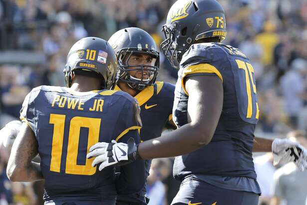 Cal's Kenny Lawler, 4 celebrates his 3rd quarter touchdown pass with teammates Darius Powe Jr, 10 and Aaron Cochran, 75 as the California Bears went on to beat the Washington State Cougars 34-28 at Memorial Stadium in Berkeley, Calif., on Sat. October 3, 2015.