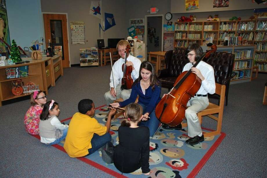 Courtesy PhotoWayland students who play with the Plainview Symphony will visit schools this week promoting the Symphony's annual Christmas concert to be Thursday night at Harral Auditorium. Brian Spruill (back left) showed his viola and Thomas Yeates demonstrated the cello while Morgan Switzenberg shows a bow to Kambry Roberts (left), Claudia Amato, Zabrin Duncan and Paisleigh Wilkens.
