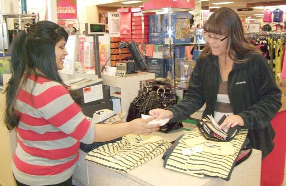 Beverly Crawford was among those exchanging Christmas gifts Wednesday. Her first stop was at Bealls, followed by Payless Shoes and Walmart. Clerk Veronica Andrade spent much of her shift ringing up sales from gift cards. Photo: Shanna Sissom/Plainview Herald