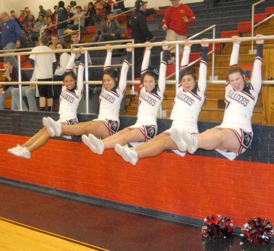 Plainview High varsity cheerleaders Mireya Garcia (left), Victoria Mireles, Kimberly Grimaldo, Mara Rodriquez and Ashley Langston show of their gymnastic skill on the parallel bars during halftime at a recent game in the Dog House. Basketball fans have a lot to cheer this weekend with the PHS Bulldogs and Lady Dogs in action at the Byron Johnston Memorial Tournament in Midland. Meanwhile, the Lady Dogs' junior varsity is playing in the Slaton tournament. The Plainview Christian High Eagles are in action at the Caprock Tournament in Lubbock, along with basketball teams from Tulia, Floydada, Olton and Abernathy. Photo: Doug McDonough/Plainview Herald
