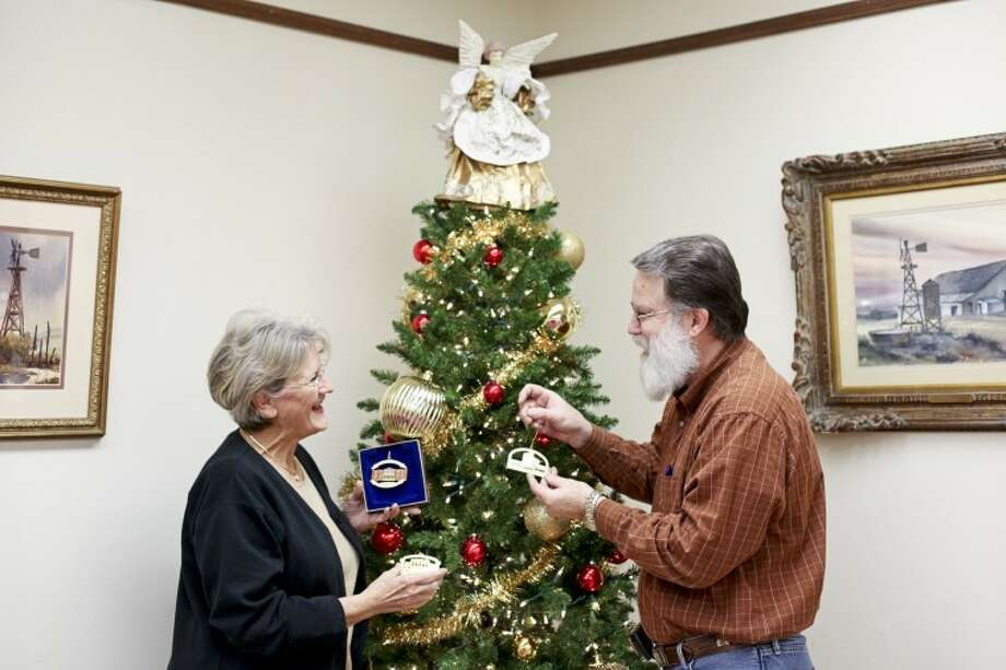 Ryan Blake Thurman/Plainview HeraldNelda Laney and Rodney Watson visit and laugh while placing the 2011 Wayland Baptist University ornaments on a tree at the Museum of the Llano Estacado, where Watson is director. Laney has designed three Wayland ornaments — Gates Hall, Matador Hall and J.E. and L.E. Mabee Learning Resources Center — a project of the Hale County Historical Commission.