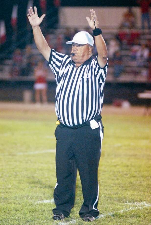 Official Sammy Gonzalez signals a touchdown in a game this season between Silverton and Kress. After 50 years of officiating, Gonzalez is retiring. Photo: Kevin Lewis/Plainview Herald