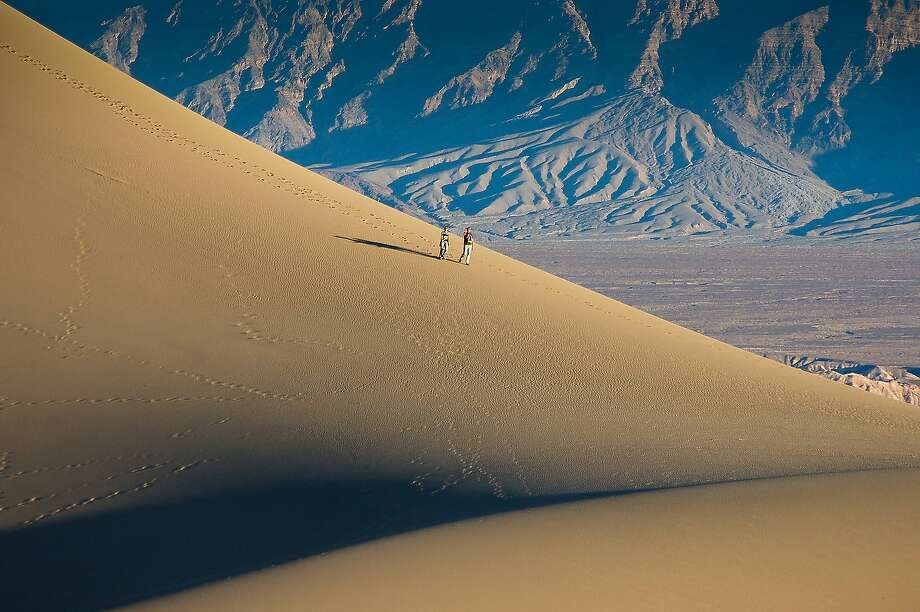MORE VIEWS OF DEATH VALLEY: Hikers descend an enormous dune at Death Valley National Park's Mesquite Flat Sand Dunes. Photo: Mike Moffitt/SFGate