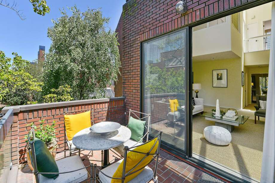 The brick patio off the living room overlooks the surrounding development.  Photo: Danny Osterweil Photography