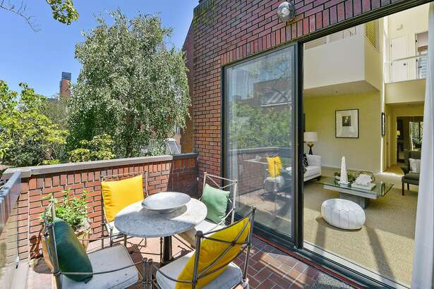 The brick patio off the living room overlooks the surrounding development.�