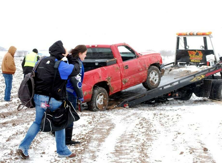 Doug McDonough/Plainview HeraldThe occupants of this pickup were able to walk away uninjured after it ended up on its side Monday afternoon after hitting an icy patch on Southwest Third Street. An almost constant barrage of weather-related traffic mishaps kept Plainview police busy Monday, but by mid-day none apparently had resulted in serious injuries. Additional snowfall Monday night along with continued freezing temperatures should make for hazardous driving conditions throughout today.