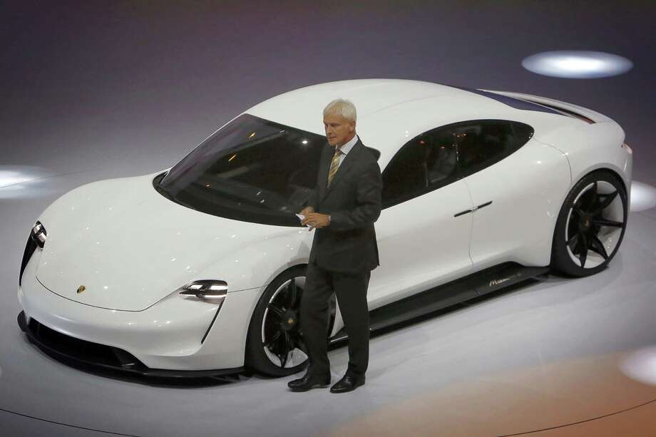 Then-CEO of Porsche, Matthias Mueller, presents the new Porsche Mission E electric car of the Volkswagen Group at the International Motor Show IAA in September in Frankfurt/Main. Porsche plans to add more than 1,400 new jobs to develop its first all-electric sports car. Photo: Associated Press /File Photo / dpa