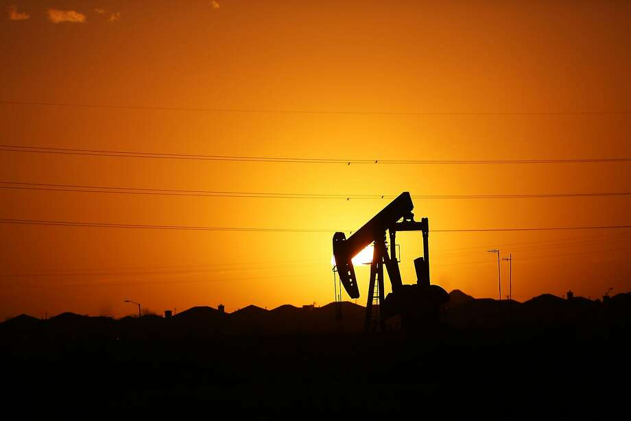 Recent changes in the U.S. corporate tax rate create an environment for increased future capital investments, including ExxonMobil's plan to spend more than $2 billion on transportation infrastructure to support its Permian operations. Photo: Spencer Platt, Getty Images