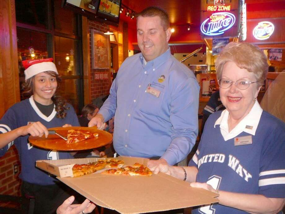 Krystal Pizana (left), Kevin Carter and Mary Anna Self box up a pizza during a Plainview Area United Way celebrity servers fundraiser at Pizza Hut on Tuesday evening when community members waited tables and gave their tips to United Way. Pizza Hut's actual wait staff also donated their tips, and more than $600 was raised for United Way. (See the Herald for group photo.)