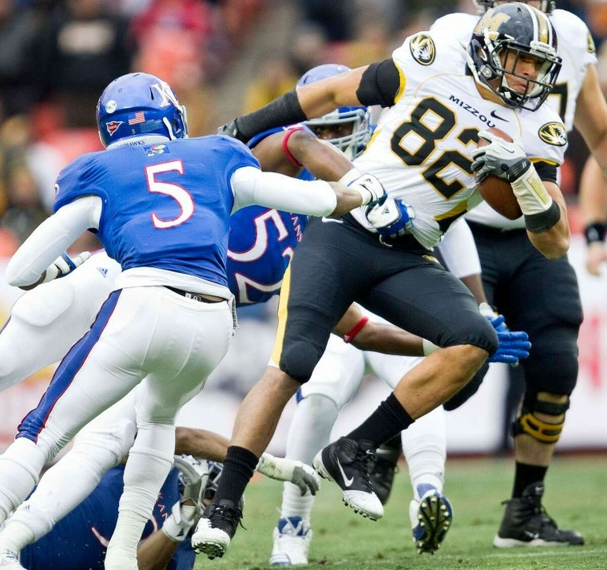 Michael Egnew (82) of Missouri battles for extra yards against Greg Brown (5) and Steven Johnson (52) of Kansas on Nov. 26, in Kansas City, Mo. Egnew was named to the All-Big 12 first team for the second year in a row.