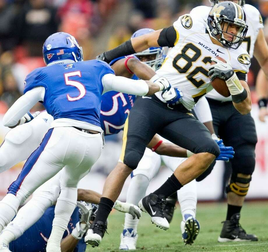 Michael Egnew (82) of Missouri battles for extra yards against Greg Brown (5) and Steven Johnson (52) of Kansas on Nov. 26, in Kansas City, Mo. Egnew was named to the All-Big 12 first team for the second year in a row. Photo: Shane Keyser/MCT
