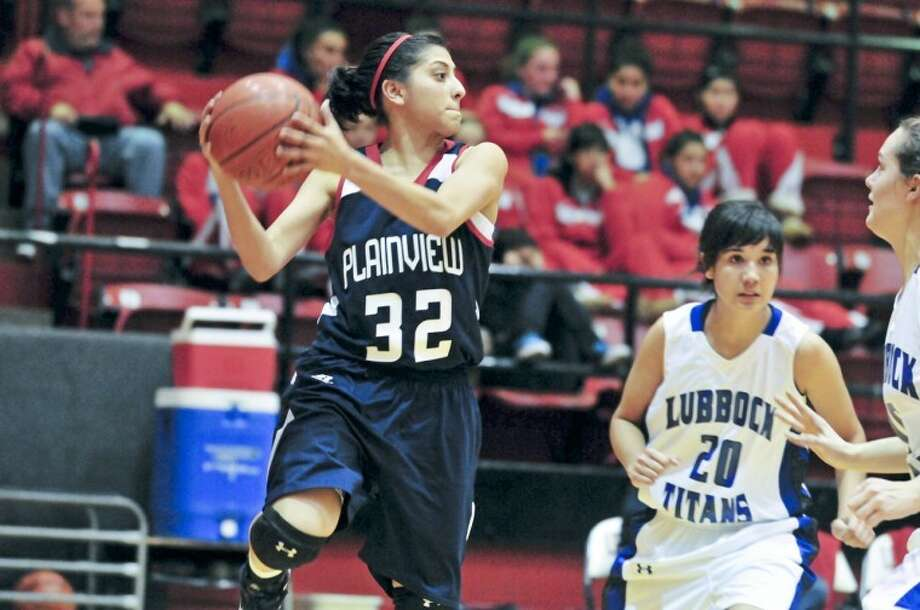 """The Plainview Lady Bulldogs' Laura Castillo (32) tries to save a ball from going out of bounds during a game against the Lubbock Titans at the Levelland Tournament. Castillo, the lone returning senior for the Lady Dogs, has been key for Plainview in non-district play. Plainview's """"second season"""" begins Friday in Dumas. Photo: Ryan Thurman/Plainview Herald"""