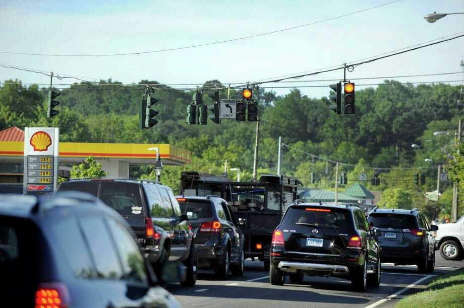 Morning traffic on Route 35, near the intersection with Farmingville Road heading into downtown Ridgefield is congested, Tuesday, July 26, 2016. A new DOT Plan will replace traffic lights at the intersection of Rt. 35, Copps Hill Road and Farmingville Road. Photo: Carol Kaliff / The News-Times