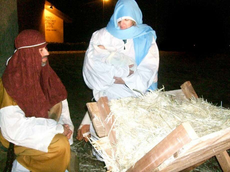 Rudy Calderon portrays Joseph and Janice Sharp is Mary holding baby Jesus as the focal point of a live nativity scene Friday night in front of the Church of Jesus Christ of Latter-day Saints. The scene, which went on in spite of temperatures hovering around freezing, also included the wise men and shepherds.