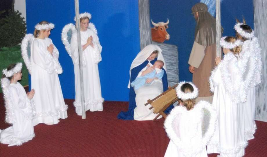 Jim Steiert/Courtesy PhotosAngels appear at the stable after the birth of the Christ child in this scene from the Christmas pageant, scheduled for Dec. 22-23 in Nazareth's Holy Family Church.