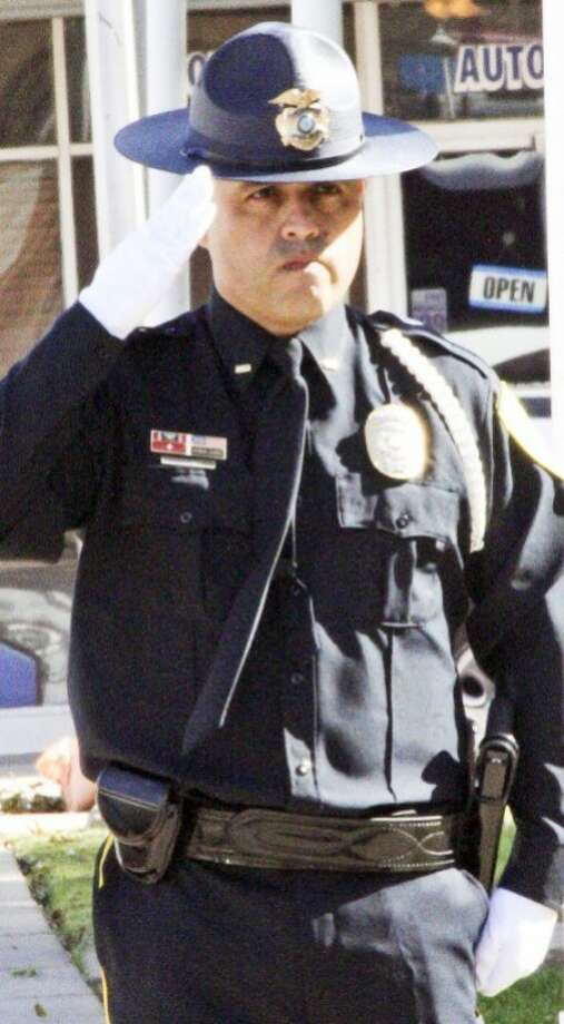 Detective Al Longoria with the Plainview Police Department Honor Guard salutes during a Veterans Day ceremony at the Hale County Courthouse.  Photo: Courtesy Photo By Eric Turner
