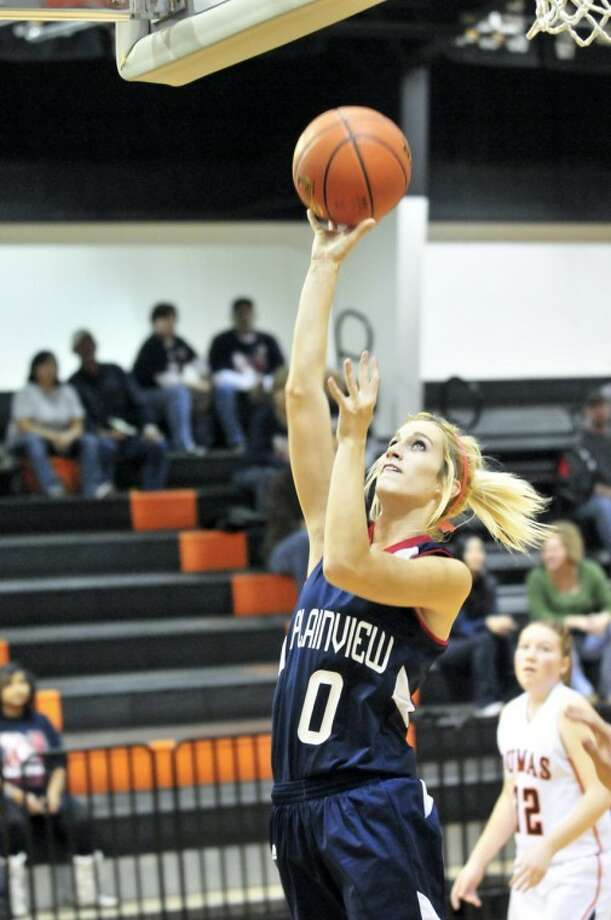 The Plainview Lady Bulldogs' Kristian Reynolds puts up a short jump shot during the Lady Dogs' 52-34 win over Dumas on Friday. The Lady Dogs host Frenship at 7:30 p.m. today in their second District 3-4A game.