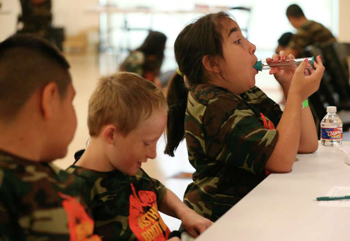 Mirakle Garcia, 12, uses a Peak Flow Meter during a free asthma boot camp hosted by the University of Texas Health Science Center San Antonio at the DoSeum, San Antonio?'s Museum for Kids, Monday, July 25, 2016. The camp is for children ages 7-12 and will help them learn about asthma prevention and triggers, among other critical information. Officials say asthma is a leading cause of absenteeism from school. The meter measures lung capacity.