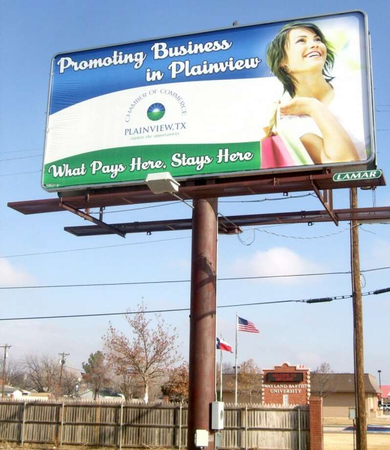 "A Plainview Chamber of Commerce-sponsored billboard along Fifth Street promotes shopping locally, touting ""What Pays Here, Stays Here."" Photo: Kevin Lewis/Plainview Herald"
