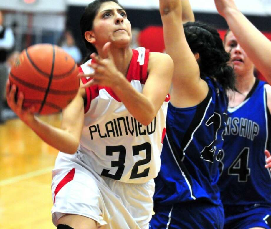 Laura Castillo (32) goes in for a layup for Plainview in Tuesday's District 3-4A game in the DogHouse. Castillo scored a career-high 31 points, but it wasn't enough as the Lady Dogs fell to Frenship in double overtime 51-47. Photo:                 Ryan Thurman/Plainview Herald