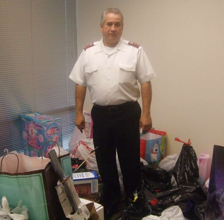 "Capt. Alfonso Martinez with The Salvation Army stands in the room where gifts are stored to give to families and children. Martinez said donations are way down, and he's not sure if all the ""angels"" will end up with gifts. Photo: Jessica Thornton/Plainview Herald"