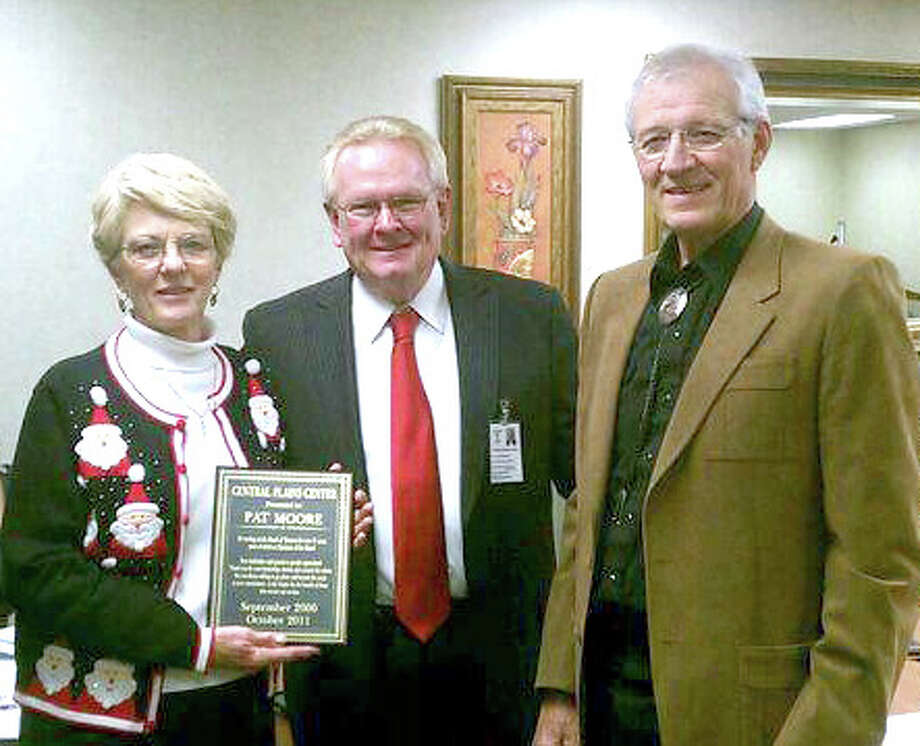 Pat Moore (left) recently was honored by the board of trustees of Central Plains Center for 11 years of service. Moore and her husband C.W., recently moved from Matador to Lubbock, prompting her resignation from the board since she no longer is a resident in CPC's nine-county service area. Here, Ron Trusler (center) CEO, and William Thompson, former Lamb County judge and current board chair, present a plaque to Moore, who is a former board chairman.
