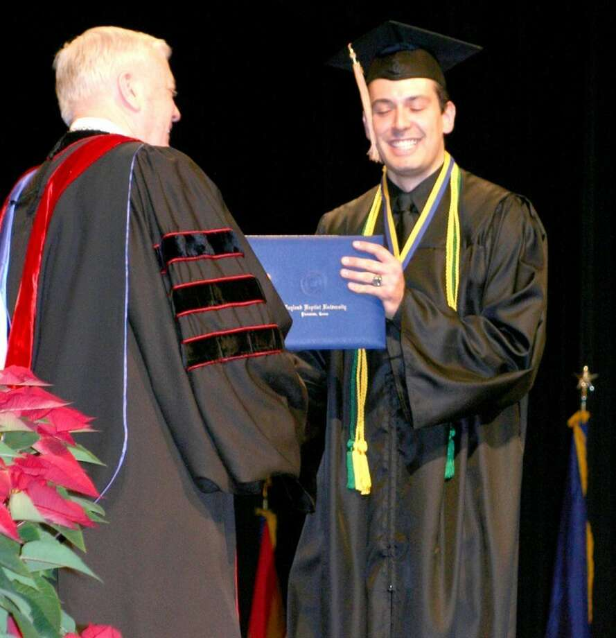 "Jonathan Petty/Wayland Baptist UniversityJoao ""Johnny"" Terra receives his diploma from Wayland President Dr. Paul Armes on Saturday afternoon as Wayland held its winter graduation ceremony."