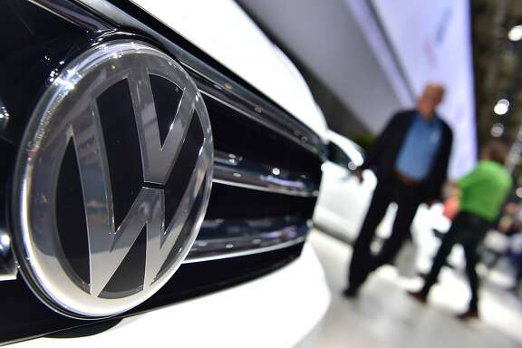 "(FILES) This file photo taken on June 22, 2016 shows a Volkswagen logo on a VW Tiguan on display during German carmaker Volkswagen shareholders' annual general meeting in Hanover.  A federal judge in California granted preliminary approval on July 26, 2016 to a $14.7 billion settlement over Volkswagen's emissions cheating scandal.""There's been an enormous effort to achieve a series of goals,"" said San Francisco district judge Charles Breyer. ""I think these goals have been achieved,"" he said, setting an 18 October deadline for final approval of the deal.  / AFP PHOTO / JOHN MACDOUGALLJOHN MACDOUGALL/AFP/Getty Images"