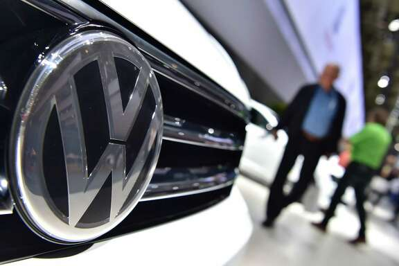 A federal judge in California granted preliminary approval Tuesday to a $14.7 billion settlement over Volkswagen's emissions cheating scandal.