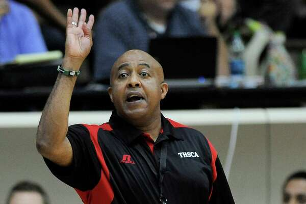South coach Lonny Hubbard, of Steele High School, yells to his players during a Texas High School Coaches Association All-Star basketball game, Monday, July 21, 2014, at Alamo Stadium in San Antonio. (Darren Abate/For the Express-News)