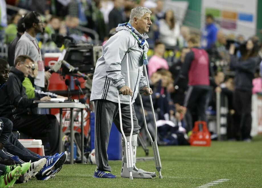 Seattle Sounders head coach Sigi Schmid, left, watches from the sideline in the first half of an MLS soccer match against the Philadelphia Union, Saturday, April 16, 2016, in Seattle. (AP Photo/Ted S. Warren) Photo: Ted S. Warren/AP
