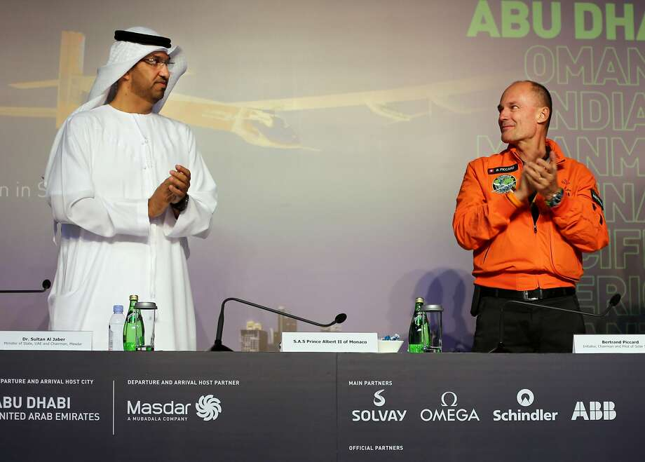 Sultan al-Jaber, UAE chairman of renewable energy company Masdar (left), shares a stage with Bertrand Piccard, one of the pilots of the experimental solar-powered plane after its landing in Abu Dhabi. Photo: Adam Schreck, Associated Press
