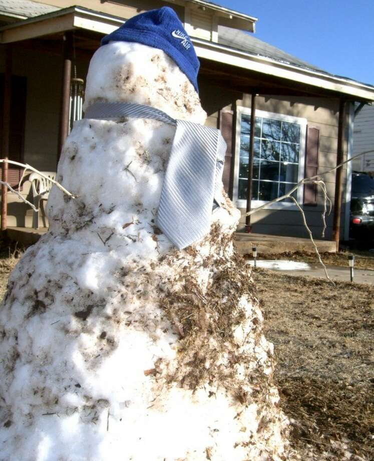 A snowman in front of a residence in the 800 block of Galveston tries to withstand the melt Monday afternoon from a weekend storm that left 4 inches of snow in Plainview. Other areas received much more, including 9 1/2 inches in Littlefield. What snow remains should disappear today when highs will be in the upper 40s. Temperatures are expected to reach into the 60s by Thursday.