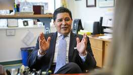 San Francisco's superintendent, Richard Carranza has a meeting with colleague Danielle Houck (right) in his office in San Francisco, California on Monday, January 4, 2016.