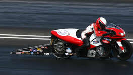 Peggy Llewellyn is a successfull female motorcycle racer on the NHRA Circuit.